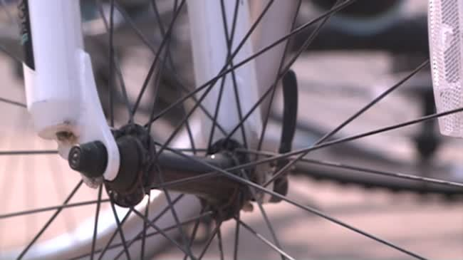 Man killed, wife and son injured while riding bicycles