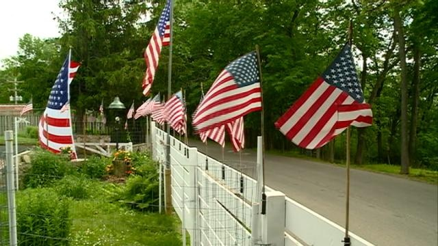 More than 50 flags fly in La Crosse yard on Flag Day