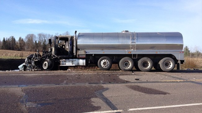 Woman dies in head-on crash with milk truck