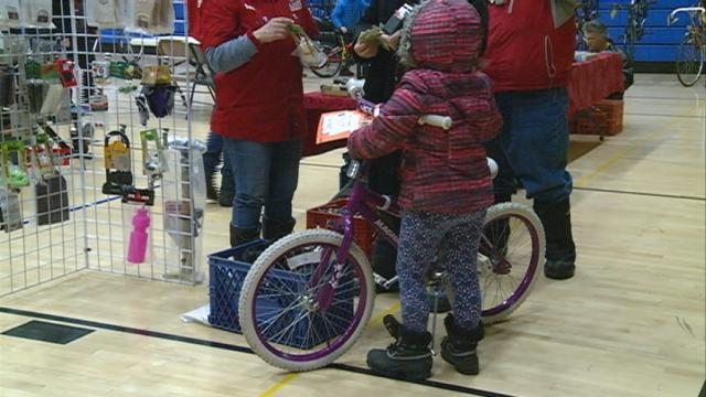 Local cyclists find great deals and help students at Bike Swap