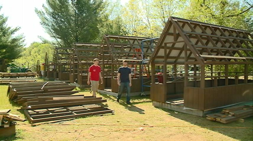 Logan High students build cabins for local boy scouts