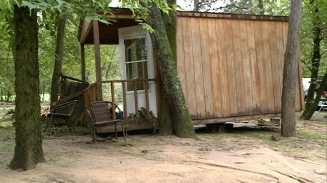 Couple rescued from cabin uprooted by flood