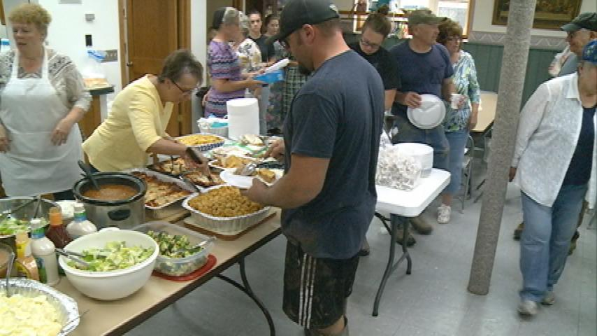 Home-cooked food offers flood victims some escape