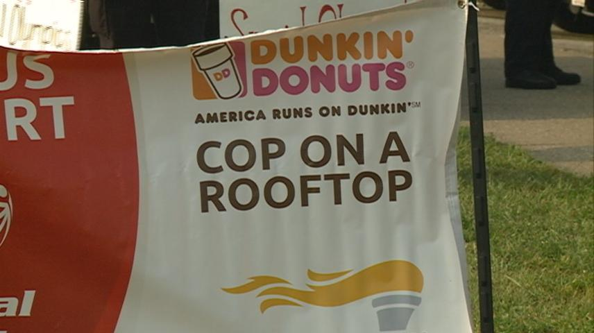 La Crosse officers spend morning on Dunkin' Donuts' roof for the Special Olympics
