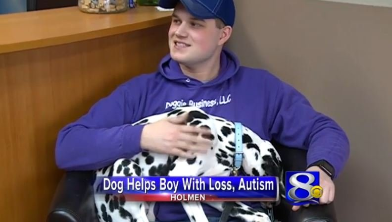 Dog helps boy with loss, Autism