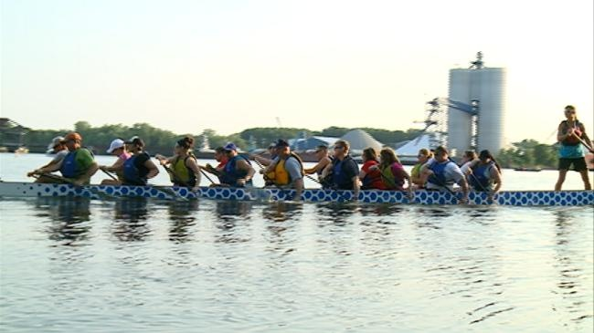 Breast Cancer survivors practice for Dragon Boat races