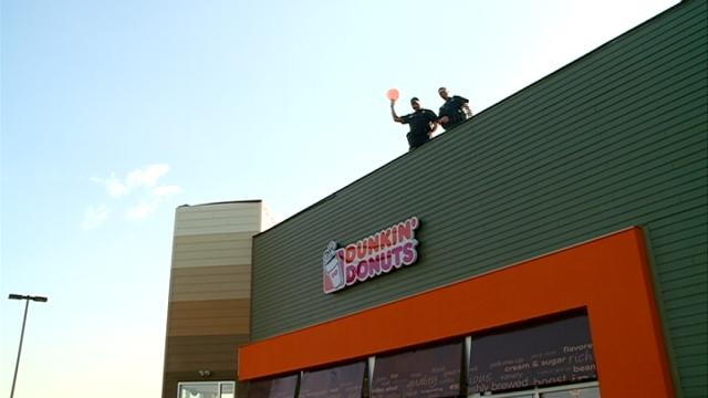 Tomah police stand on roof of Dunkin' Donuts for good cause