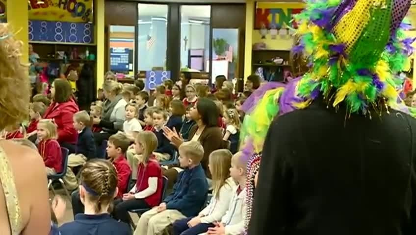 Mardi Gras Rex and Queen visit area catholic schools
