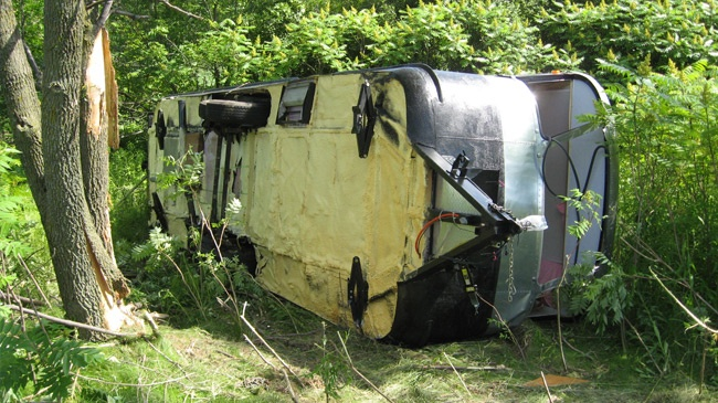 Woman dies after pickup, camper trailer rolls into Dunn County ditch