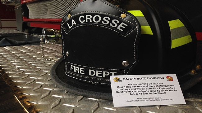 La Crosse Fire Department and Green Bay Packers hold 'Fill the Helmet' campaign