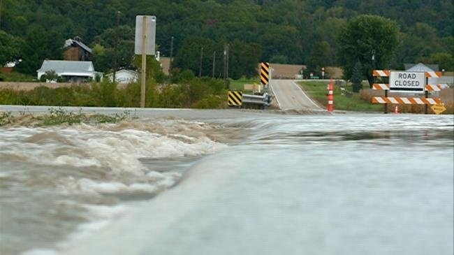 Flooding brings mudslides, closed highway