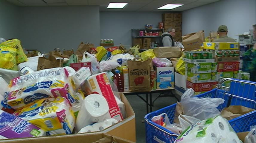 Aquinas students drop off 4,100 pounds of food, items to WAFER food pantry