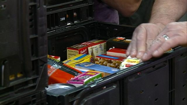 Mailmen help to stamp out hunger with food drive