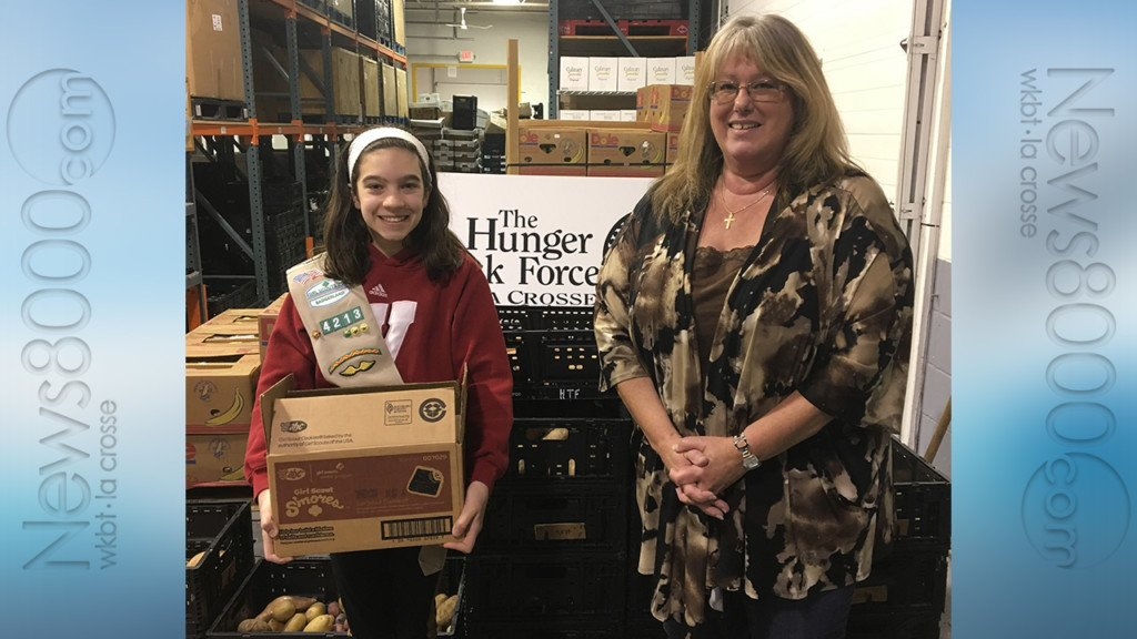 Badgerland Girl Scouts and La Crosse County Dairy team up to fill pantry shelves