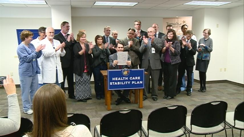 Walker signs bill to help reduce health insurance premiums during visit to Tomah