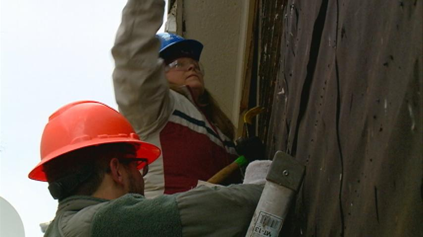 Veterans continue service by rebuilding home for La Crosse family in need