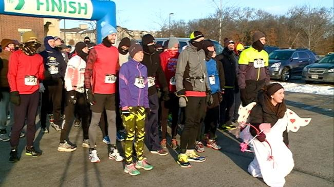 Runners take part in outdoor event despite cold temperatures