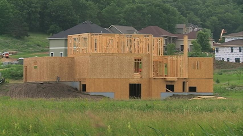 Home building takes hit nationally, stays positive locally
