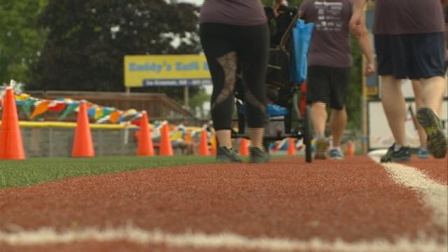 Over 230 people run the bases at Copeland Park, and then some