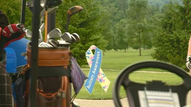 Community members hit the links for autism