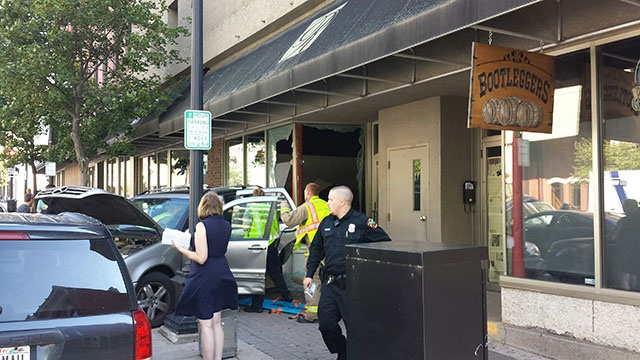 One injured after car hits downtown La Crosse building