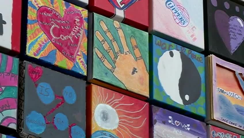 Compassion tiles to hang permanently on La Crosse middle school walls