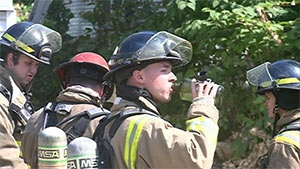 Firefighters work to stay cool during heat wave