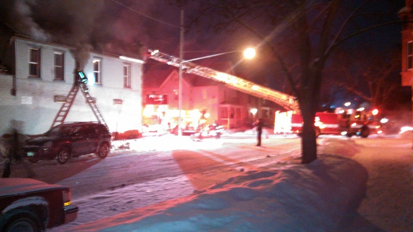 Firefighters battle structure fire in cold temperatures