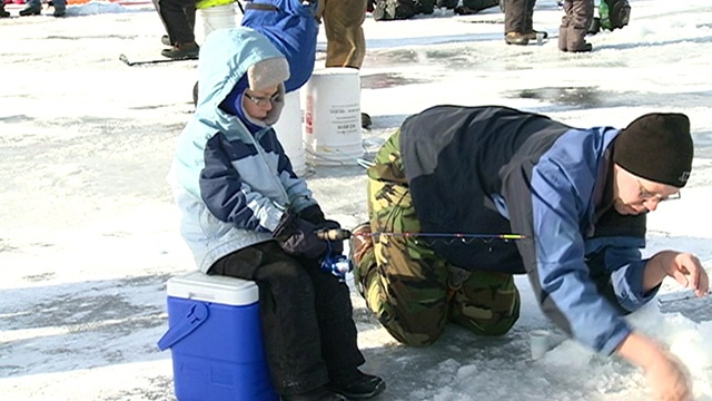 Children celebrate Kids Ice Fishing Event