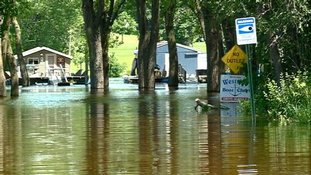 Flood waters create challenges for boat house owners