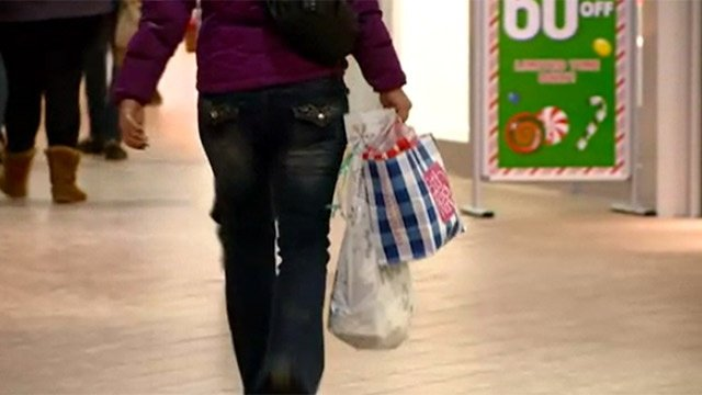 Last-minute shoppers filling stores before Christmas
