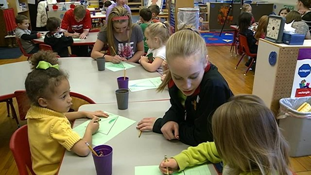 High school students help preschoolers write letters to Santa
