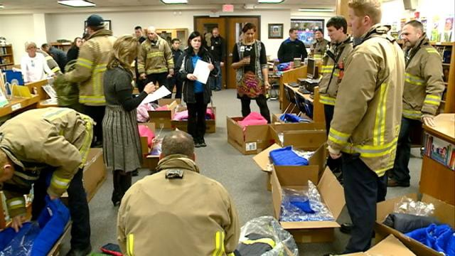 La Crosse firefighters donate winter coats to local kids