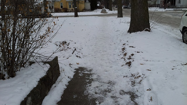 City crews clear sidewalks, charge property owners