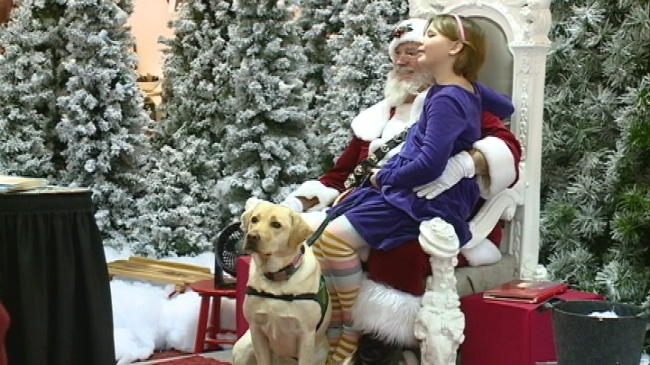 Area girl and service dog get special meeting with Santa