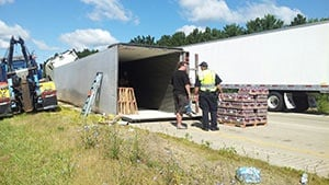 Semi carrying sports drinks rolls over on I-90 near Sparta