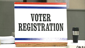 Eliminating same-day registration would cost $5M