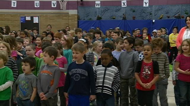 Local students perform 'Imagine Compassion' song