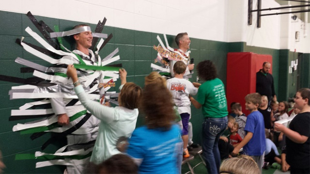 La Crescent principal, teacher duct taped to wall