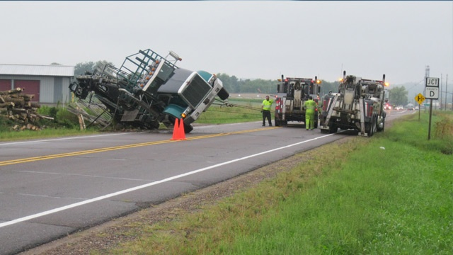 Log truck overturns on Hwy 12 in Eau Claire County