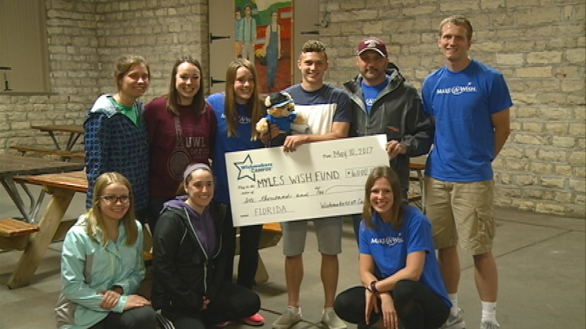 Make-a-Wish presents check to Logan High student