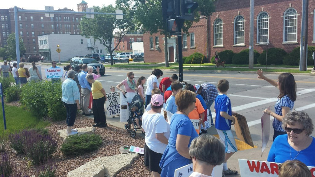 About 100 gather in protest of the hospital abortion issue