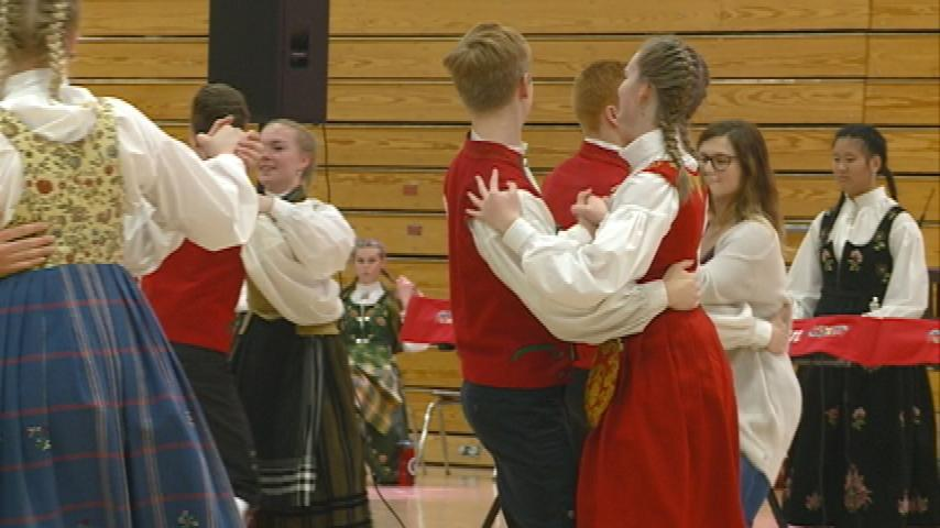Students perform traditional Norwegian dances in Holmen
