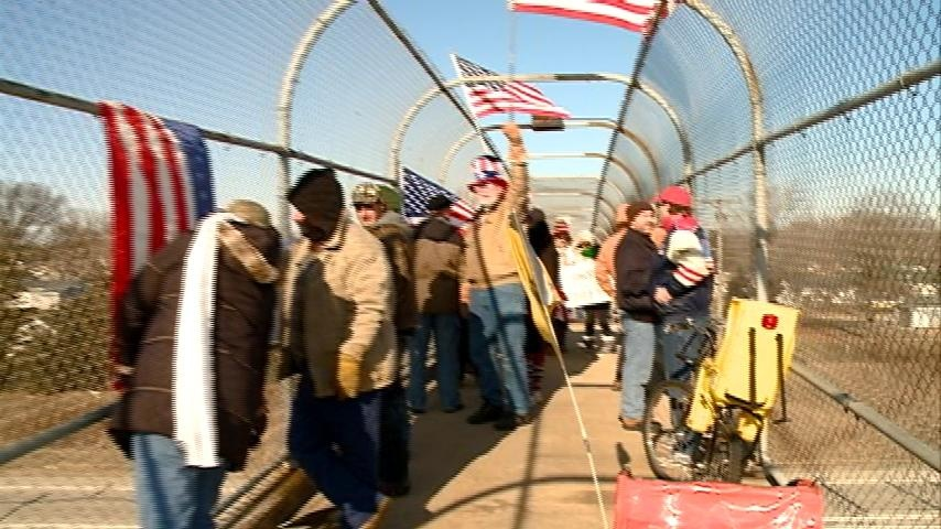 Protesters rally for free speech on overpass