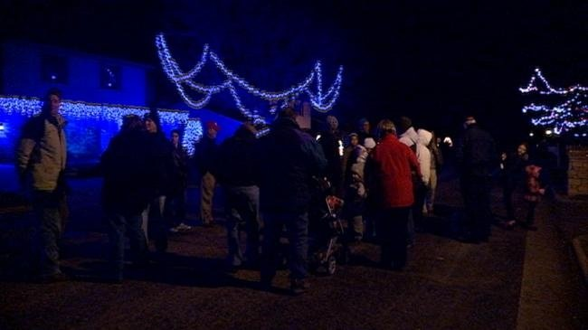 Neighbors on 'Christmas Street' light up for 25th anniversary