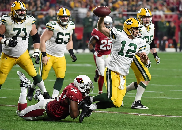 Cardinals sack Rodgers 8 times, rout Packers 38-8
