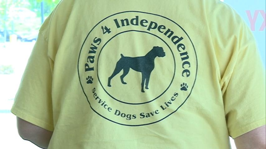 Grand opening raises money for 'Paws 4 Independence' foundation