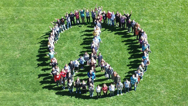 Viterbo students form human peace sign in La Crosse