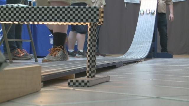 Pinewood Derby teaches area kids how to turn a block of wood into a race car