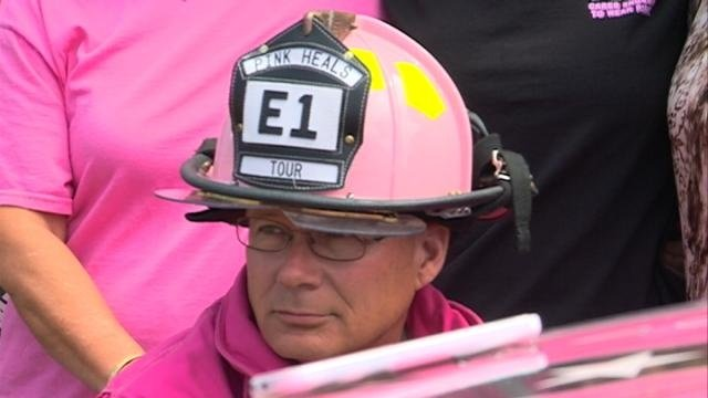 Firefighters wear pink, drive pink truck for breast cancer awareness